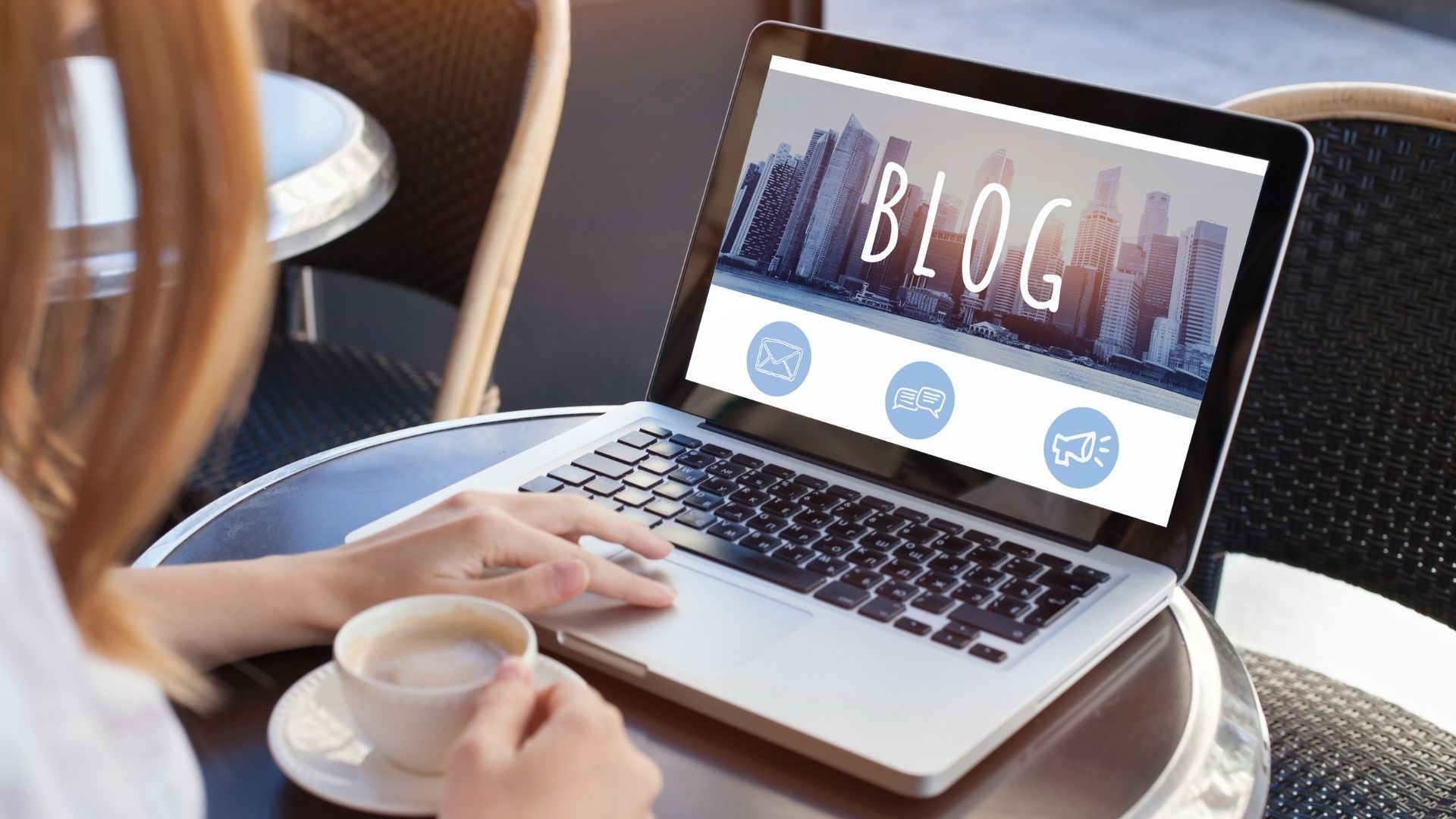 Blog Traffic Woman writing blog on laptop